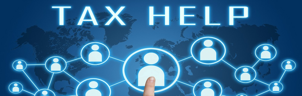 Tax Help concept with hand pressing social icons on blue world map background.